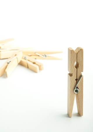 Wooden clothes pegs on light background Stock Photo - 17334551