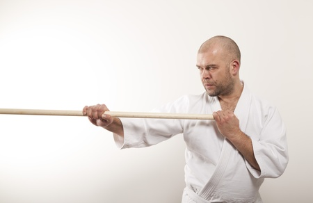 Man with a stick on a light background Stock Photo - 17531339