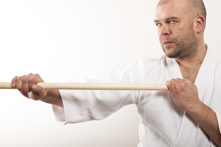 Man with a stick on a light background Stock Photo - 17531340