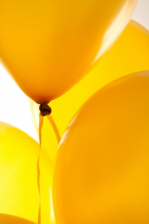 Yellow balloons on light background photo