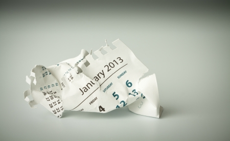 January. Calendar sheet. Crumpled paper on the floor. photo