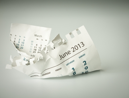 June. Calendar sheet. Crumpled paper on the floor. photo