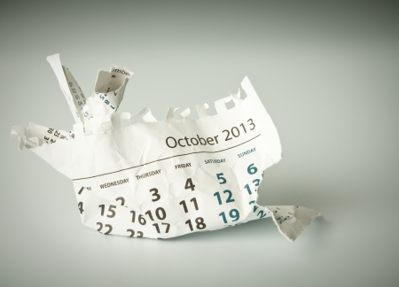 October. Calendar sheet. Crumpled paper on the floor. photo