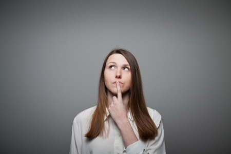 confused woman: Girl full of doubts and hesitation