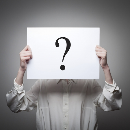 Woman having no answers to a question Stock Photo