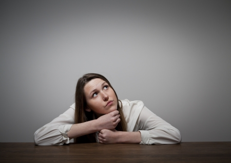 Thinking  Girl solving a problem  Stock Photo