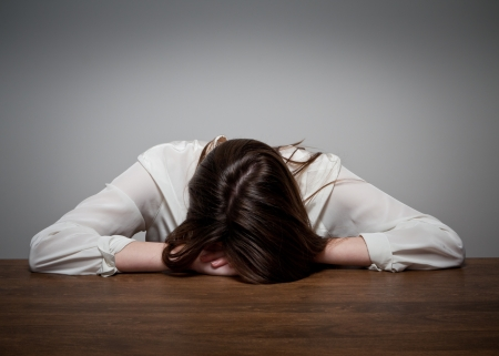 Sad young woman. Expressions, feelings and moods. Sorrow. Stock Photo