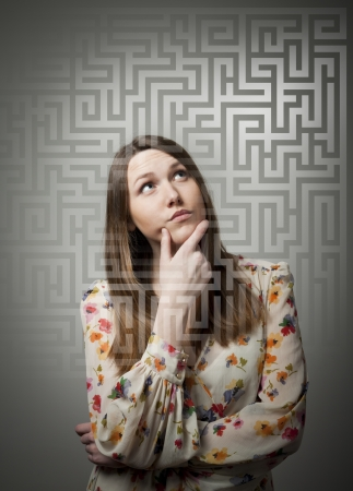 woman hard working: Young woman looking for the solution.  Stock Photo
