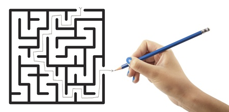 Woman hand drawing, solving maze on white background photo
