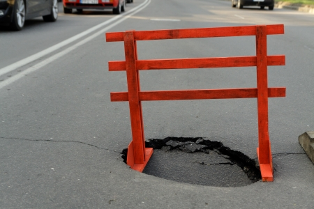 warning sign and a hole on the road Stock Photo - 19684860
