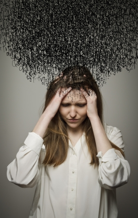 alone and sad: Young woman suffering from dark thoughts. Stock Photo