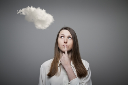 Girl and cloud. Girl thinking. Imagination concept. Stock Photo - 20340790
