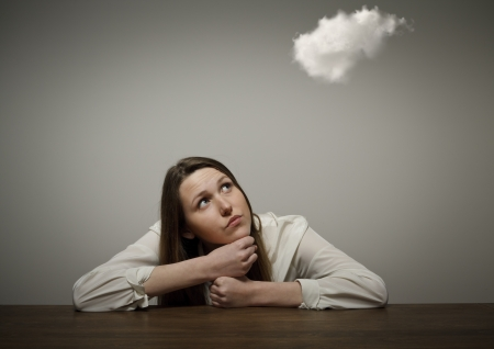 Girl and cloud. Girl thinking. Imagination concept.