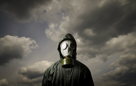 radiation pollution: Man wearing a gas mask on his face