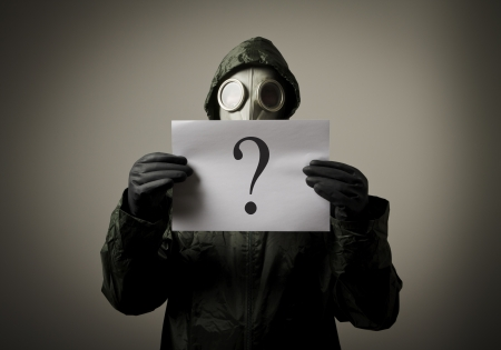Gas mask and question  Man having no answers to a question photo