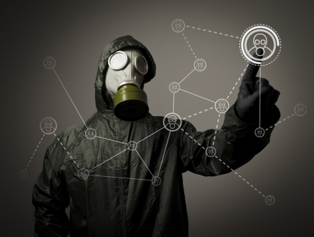 chemical warfare: Man wearing a gas mask on his face  Social network in the future  Stock Photo
