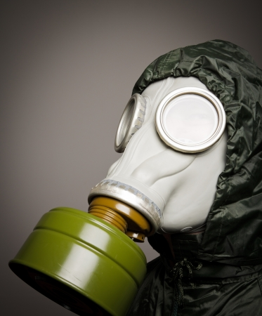 Man wearing a gas mask on his face photo