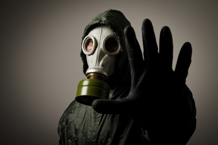 chemical warfare: Man wearing a gas mask on his face