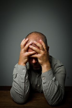 tiring: Headache  Expressions, feelings and moods  Man suffering from headache Stock Photo