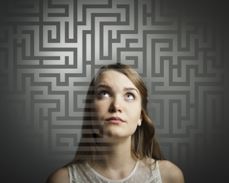 Girl in white full of doubts and hesitation  Girl looking for the solution  Stock Photo