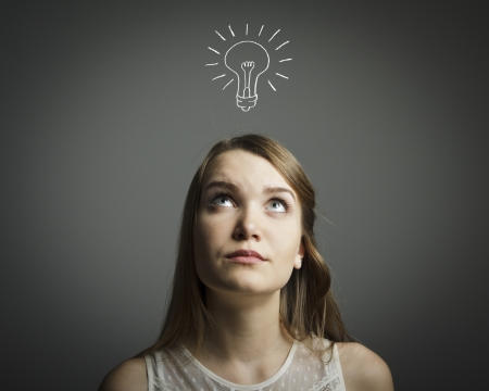 reasoning: Girl in white having an idea with light bulb over her head