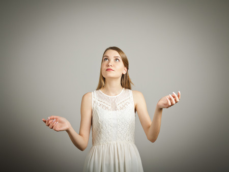 Girl in white is juggling. Concentration concept. Stock Photo