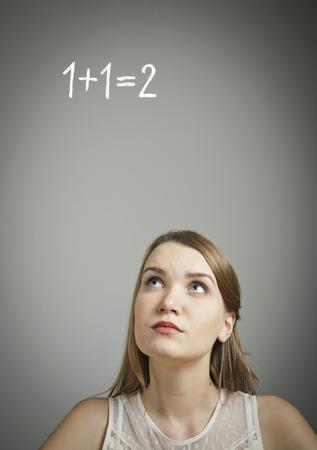 proper: Girl in white finding the solution  Task concept