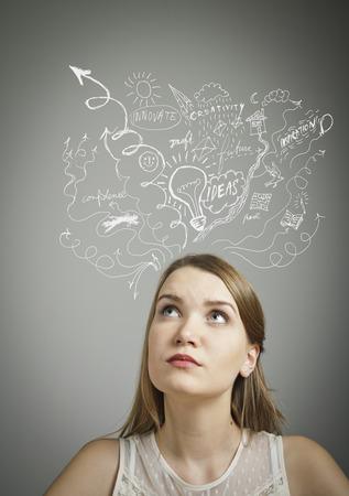 hesitation: Girl in white full of ideas and hesitation  Stock Photo