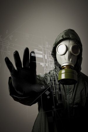 Man wearing a gas mask on his face  Gas mask and city map  Evacuation concept  photo