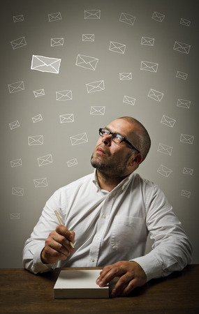 Man in white is ready to write something  Man in white looking at the letters  photo