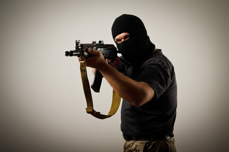Man in mask with gun photo