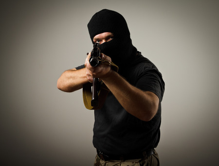 Man in mask with gun  Russian terrorist  photo