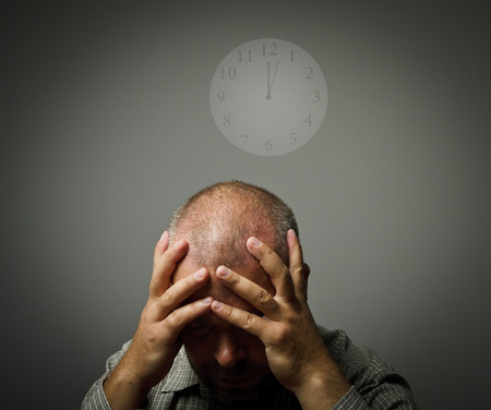 tiring: Man in thoughts and several minutes past twelve  Time concept  Stock Photo