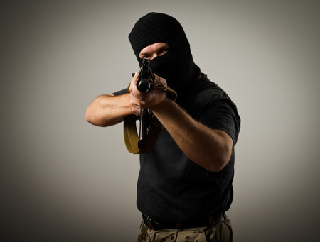 Man in mask with gun  Russian terrorist