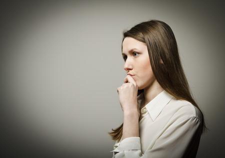 hesitation: Girl full of doubts and hesitation. Girl is thinking.
