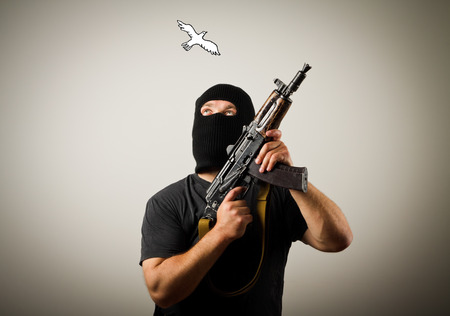 attacker: Man in mask with gun and peace dove.