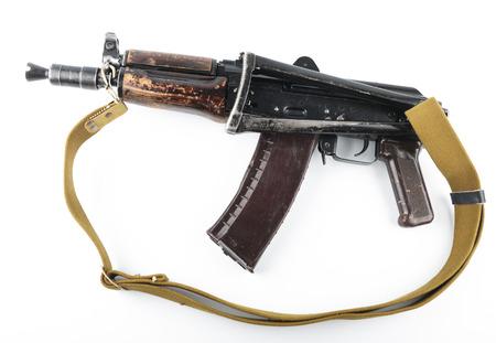 blowpipe: Kalashnikov rifle on bright background.