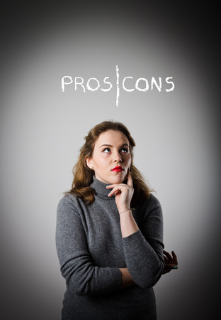 pros: Girl in grey is thinking. Pros and cons concept.