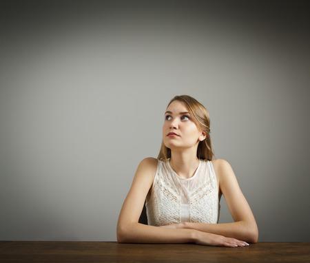 hesitation: Girl in white full of doubts and hesitation. Girl solving a problem.