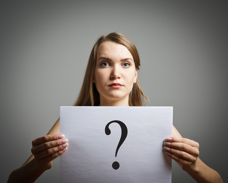 obscurity: Girl in white having no answers to a question.