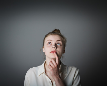 hesitation: Girl full of doubts and hesitation. Young slim woman. Stock Photo