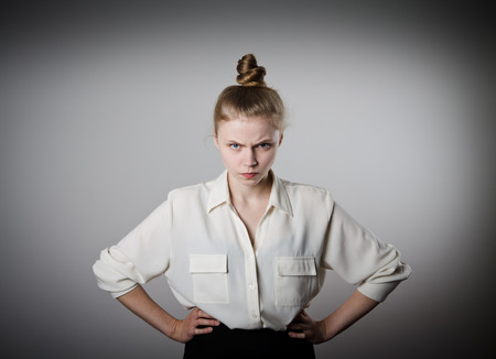 women: Angry young slim woman in white.