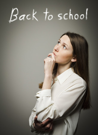 hesitation: Back to school concept. Girl full of doubts and hesitation. Thinking.