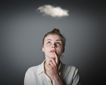 mystique: Young slim woman and cloud. Imagination concept. Stock Photo