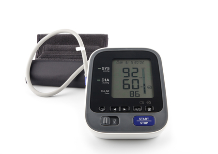 hypotension: Digital Blood Pressure Monitor on bright background. Hypotension concept.