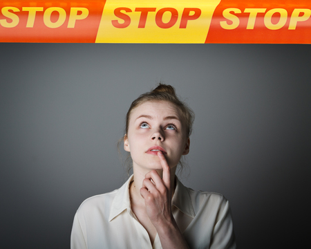 bound woman: Young slim woman and STOP line over her head. Restricted area concept. Stock Photo