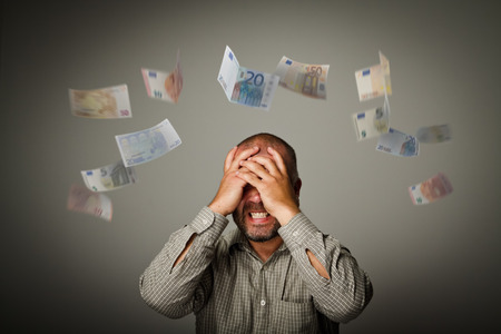 chagrin: Frustrated man. Taxes and debts. Expressions, feelings and moods. Falling Euro.