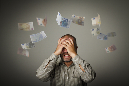 despite: Frustrated man. Taxes and debts. Expressions, feelings and moods. Falling Euro.