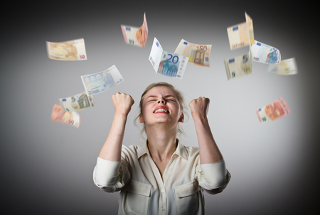 lottery win: Rejoicing. Young slim woman and falling Euro banknotes. Success, currency and lottery concept.