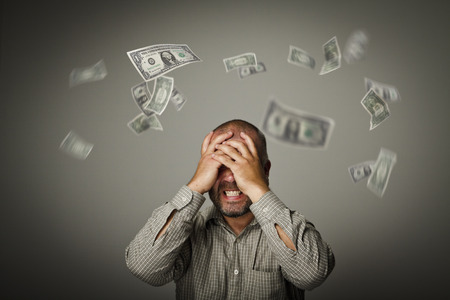 moods: Frustrated man. Taxes and debts. Expressions, feelings and moods. Falling dollars.